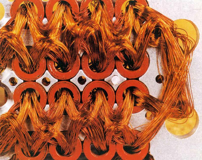 Núcleos de ferrita cosidos con cables de cobre
