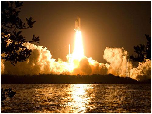 Despegue del Discovery - NASA/Sandra Joseph, Kevin O'Connell