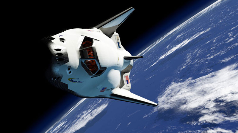 Impresión artística de una Dream Chaser en órbita